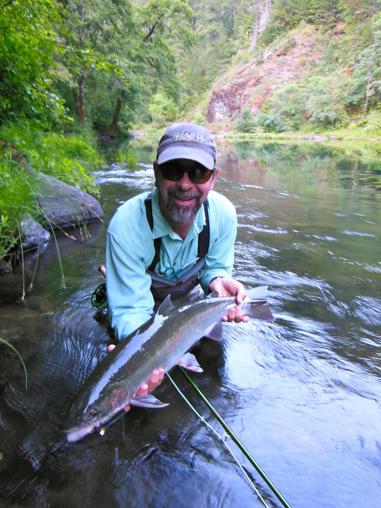 Craig with a big bright dry fly umpqua river buck photo for Fly fishing guide jobs