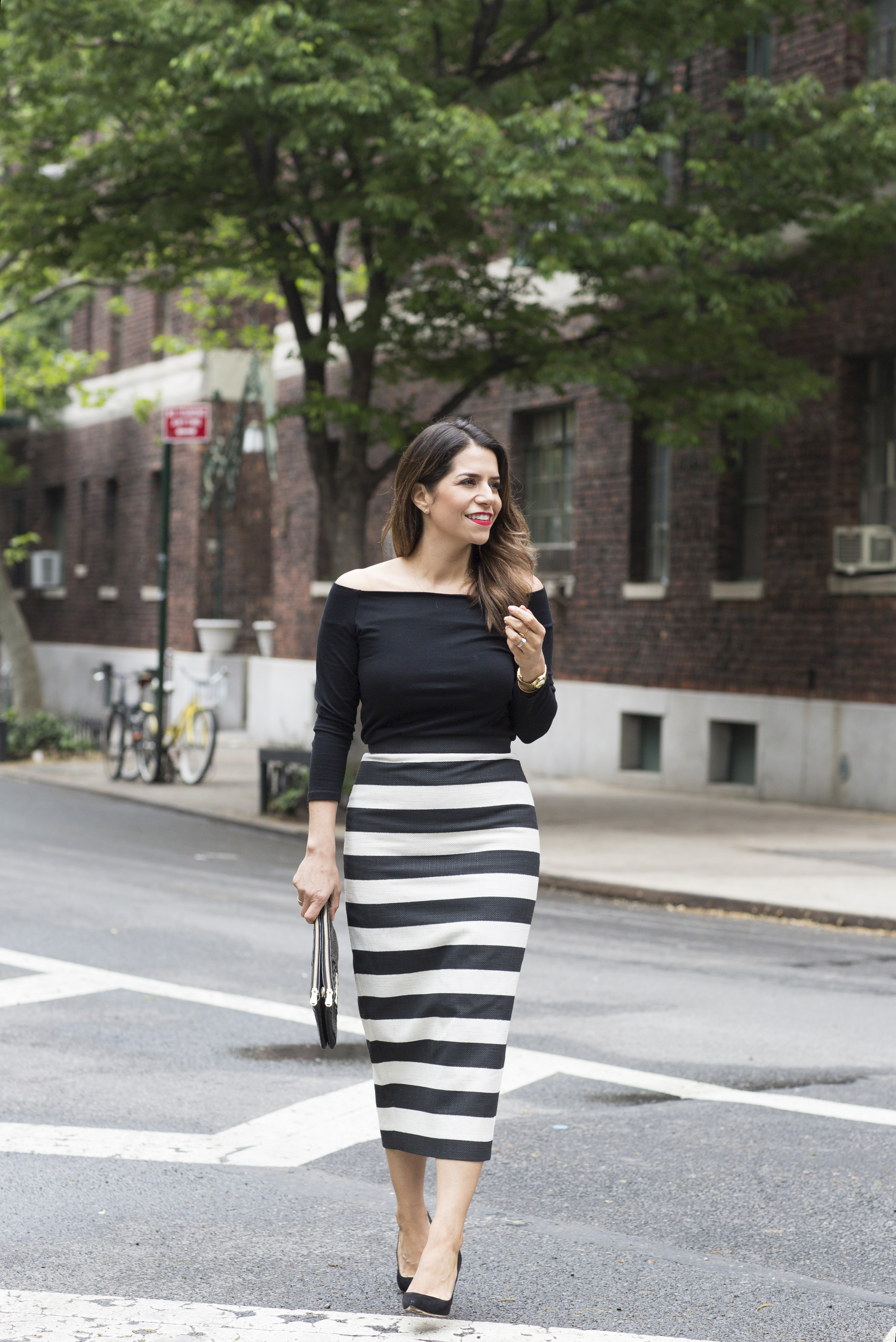black and white stripe skirt with off the shoulder black top in spring on corporate catwalk