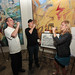 Chef Joe Miller of Joe's and Bar Pintxo and Lisa Mattson of Jordan Winery toast 4 on 4 LA First Runner-up Winner Artist Mark Dean Veca (center) at Jordan Winery's 4 on 4 Art Competition at Hadid Gallery on April 11
