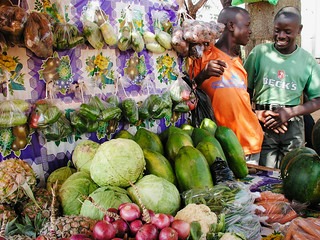 A fruit and vegetable stand in Kampala | by World Bank Photo Collection