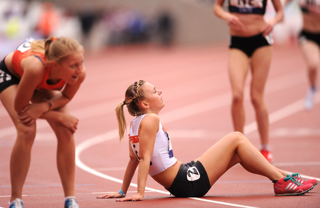Exhausted Athletes After Athletics Run In Olympic Stadium