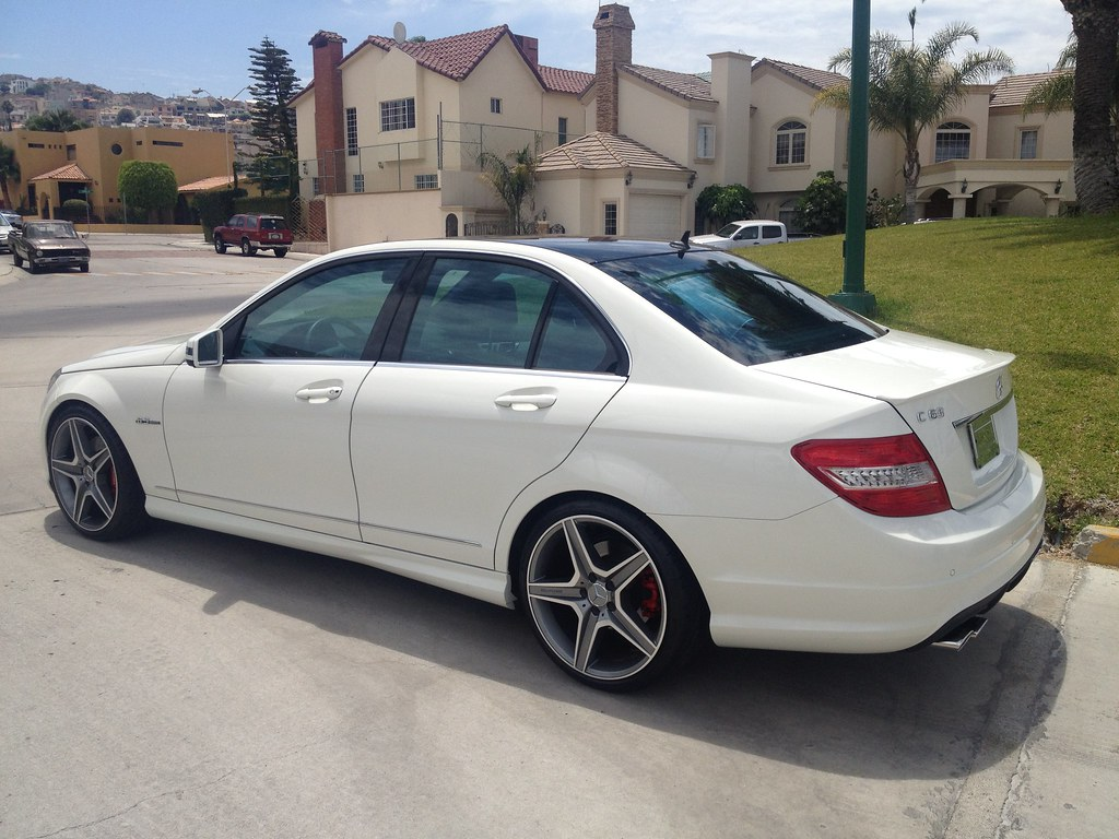 Mercedes benz amg c 63 2011 white black top brembo for Mercedes benz blue window tint