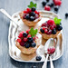 tarts with cream and fresh berries