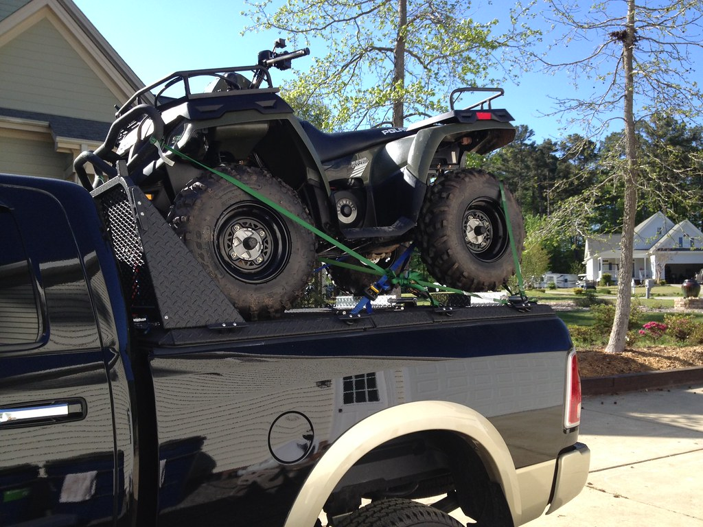 Quad On Atv Carrier On Ram Pickup An Atv Sits On Top Of
