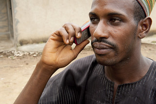 Ismail on mobile telephone | by World Bank Photo Collection