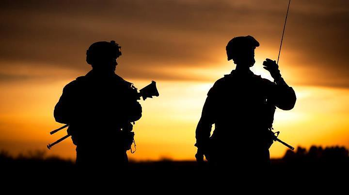 sunset silhouette soldiers from delta company 2108th