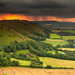 Sunset after cloudburst on South Downs from Devils Dyke