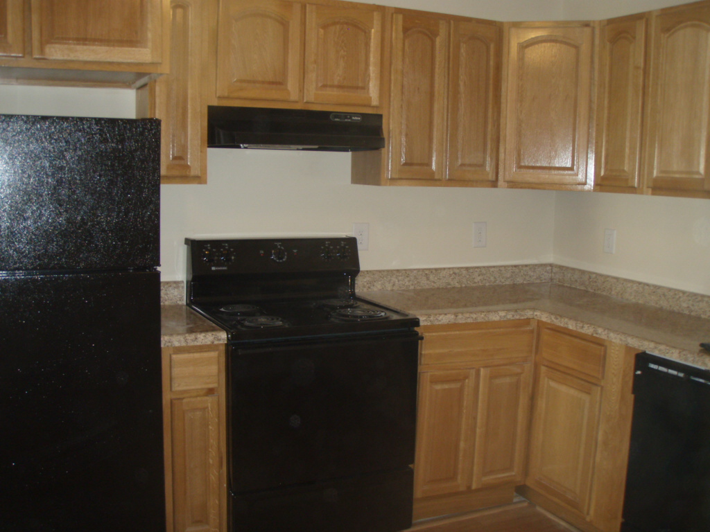 Kitchen with oak cabinets and black appliances kitchens for Black kitchen cabinets online