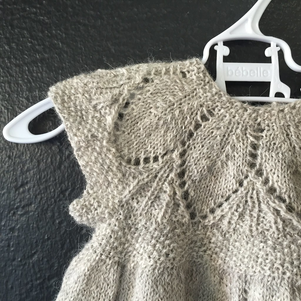 close up of sleeve and shoulder of knitted 'clara' dress, knitted in isager alpaca merino in a silver colour