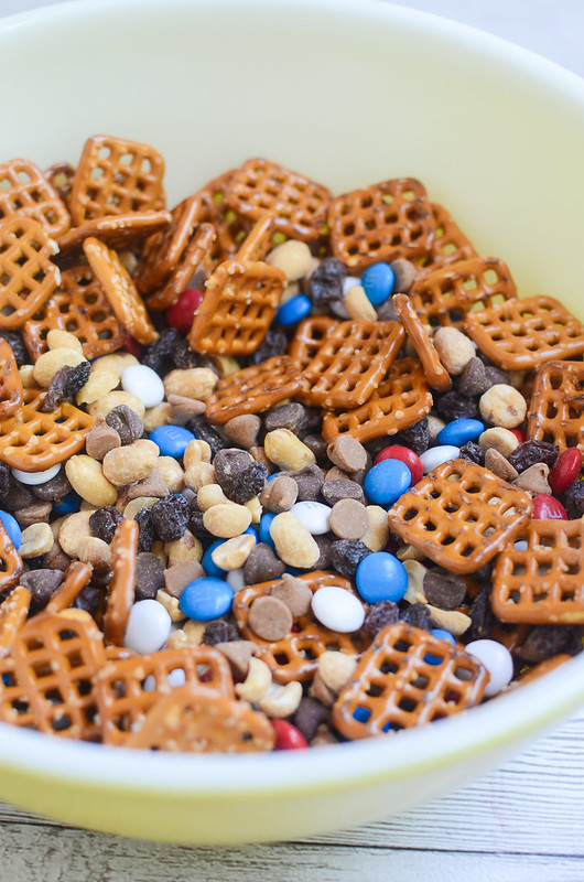 Monster Trail Mix - the ultimate roadtrip snack mix! Pretzels, chocolate chips, peanut butter chips, raisins, peanuts, and M&Ms!