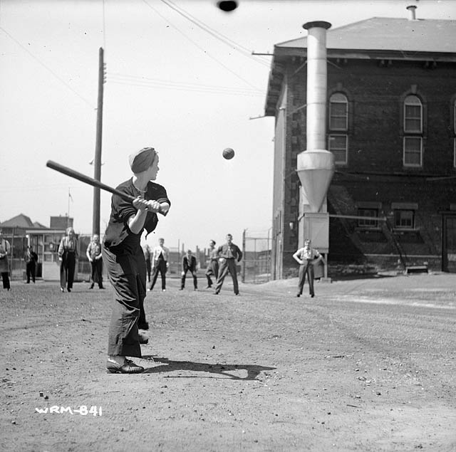 Women munitions workers play a game of baseball at the Joh ...