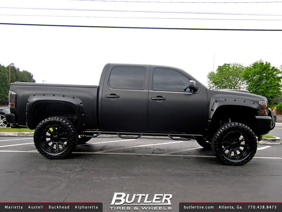 Satin Black Chevy Silverado With 22in Xd Misfit Wheels