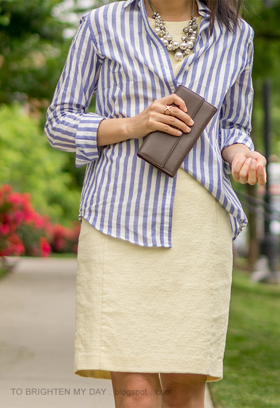 pearl cluster necklace, blue striped button up shirt, pale yellow shift dress, taupe clutch