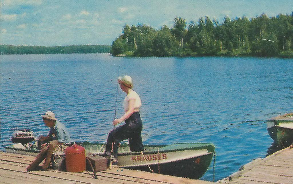 Up barbeau mi 1950s fishing boat docks at krauses resort a for Fishing docks near me