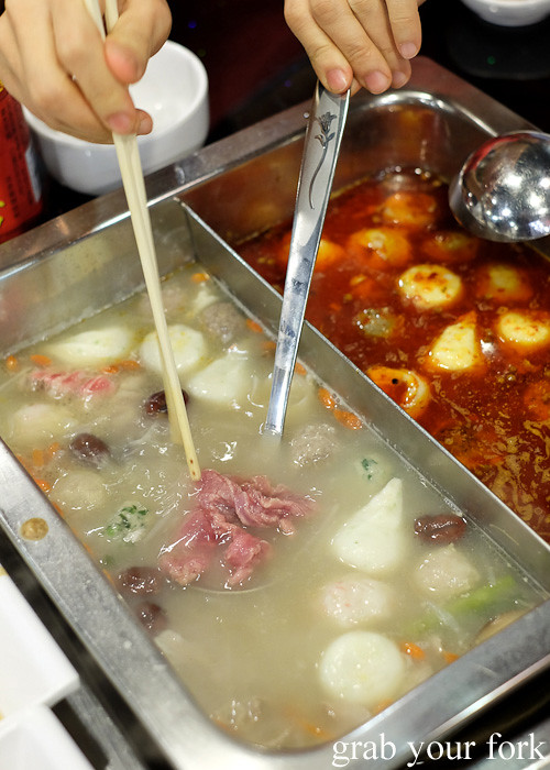 Cooking beef slices in the chicken stock at Shancheng Hotpot King, Sydney