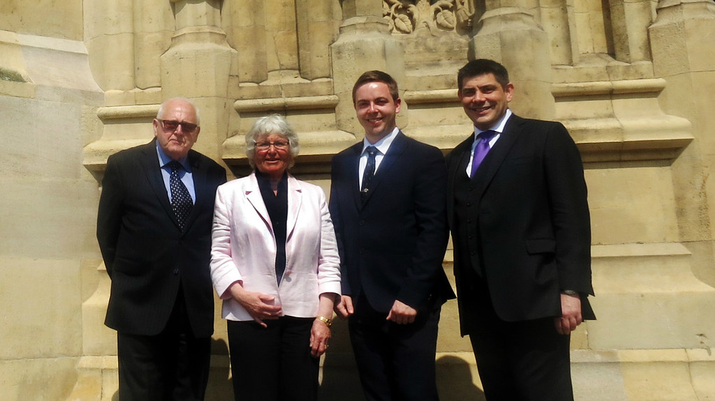 Photography of Roger Whorrod OBE, Sue Whorrod, Ben Metcalfe and Dr Brian Nicholson standing together