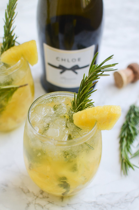 Pineapple Rosemary Crush - easy cocktail recipe with pineapple, rosemary, and sparkling wine! Perfect for a party.
