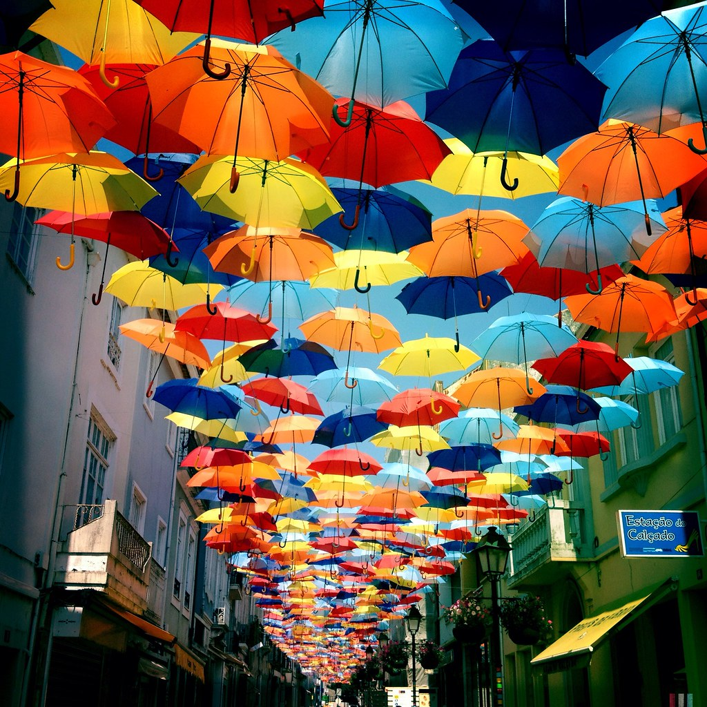 umbrella roof in july in gueda a portuguese town some. Black Bedroom Furniture Sets. Home Design Ideas