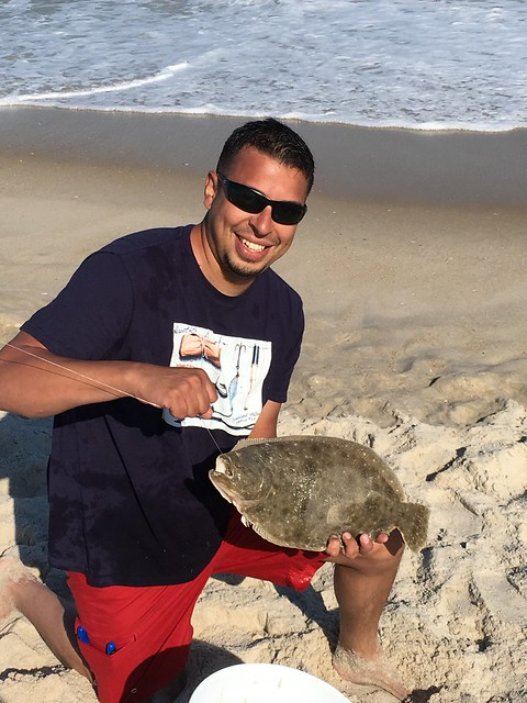 Photo courtesy of Elmer Merino holding a summer flounder