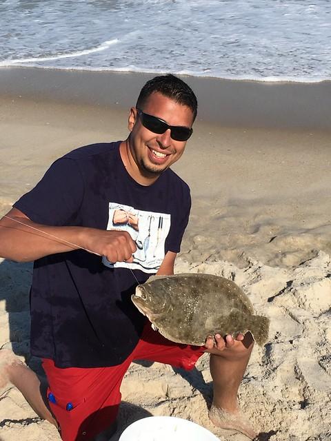 Photo courtesy of Elmer Merino holding a summer flounder