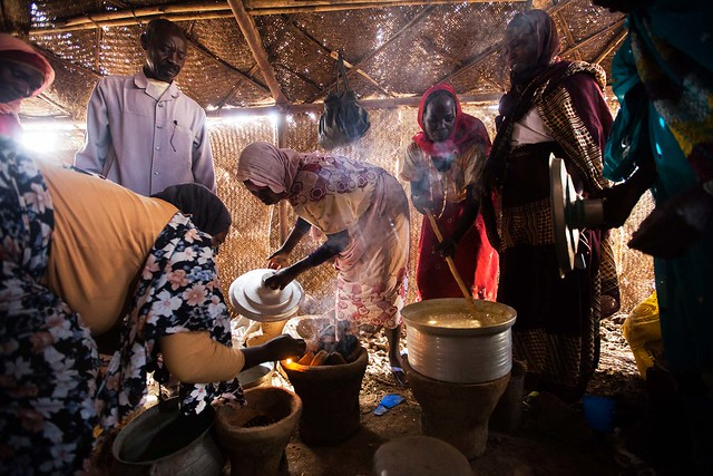 Women use fuel-efficient stoves to cook their meals in Sudan