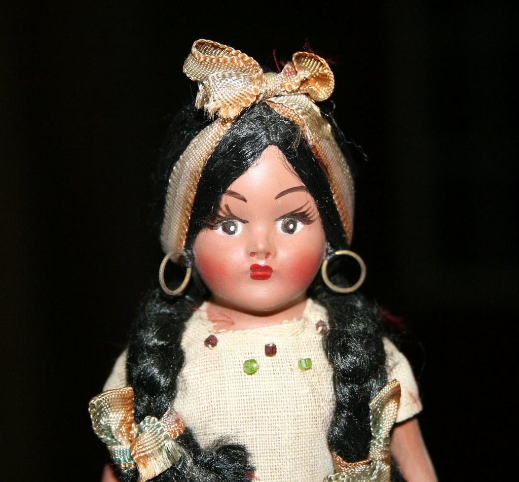 Here against vintage mexican doll join told
