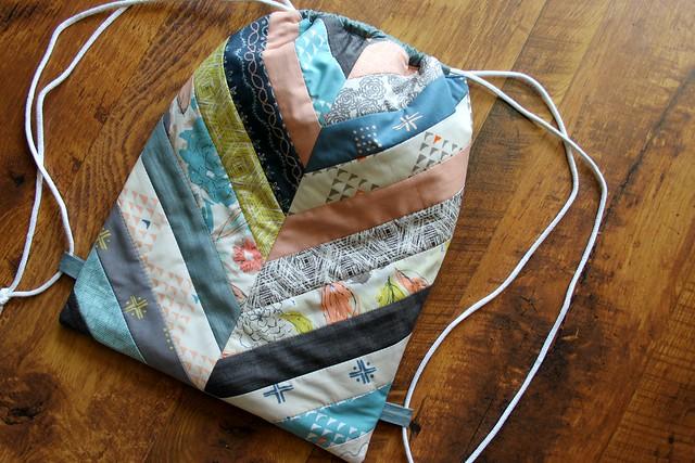 A Herringbone Drawstring Backpack
