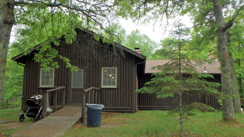 brown log building with a ramp up to the door