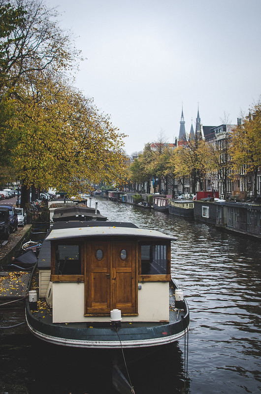 A houseboat parked along an Amsterdam canal.