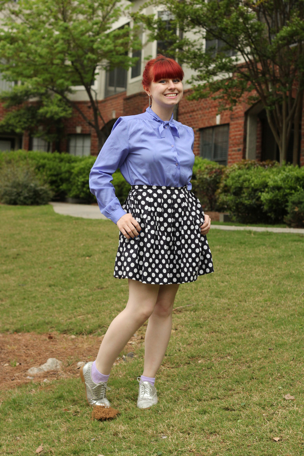 Retro Bow Neck Blouse with a Pleated Navy Blue Polka Dot Skirt and Silver Oxford Shoes
