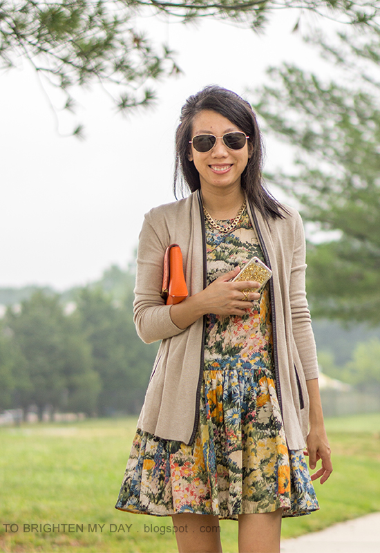 camel piped open cardigan, watercolor floral dress, orange clutch, gold jewelry