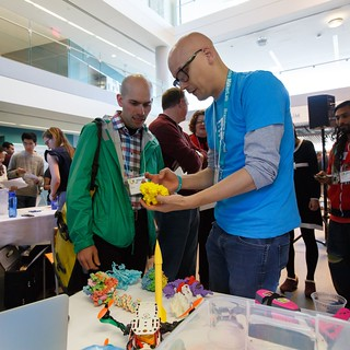 Ian Roy of the MakerLab shows a 3D printed molecule to a showcase attendee.