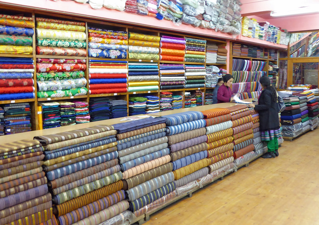 woman shopping in fabric shop thimphu this shop is locat flickr. Black Bedroom Furniture Sets. Home Design Ideas