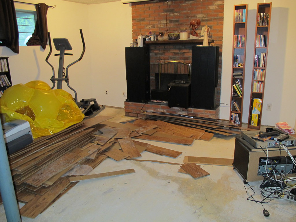 The damage done in a wet basement is documented for insurance claim