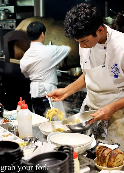 Plating the Turkish ravioli at Mercado restaurant, Sydney