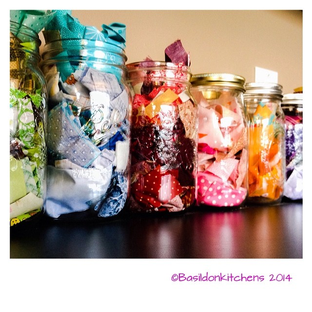 10/2/2015 - original craft idea {not so much crafty as organizational; mason jars on my counter for my scraps, sorted by colour. Useful & pretty too} #photoaday #original #craft #idea #masonjars #scraps #fabric #rainbow #pretty
