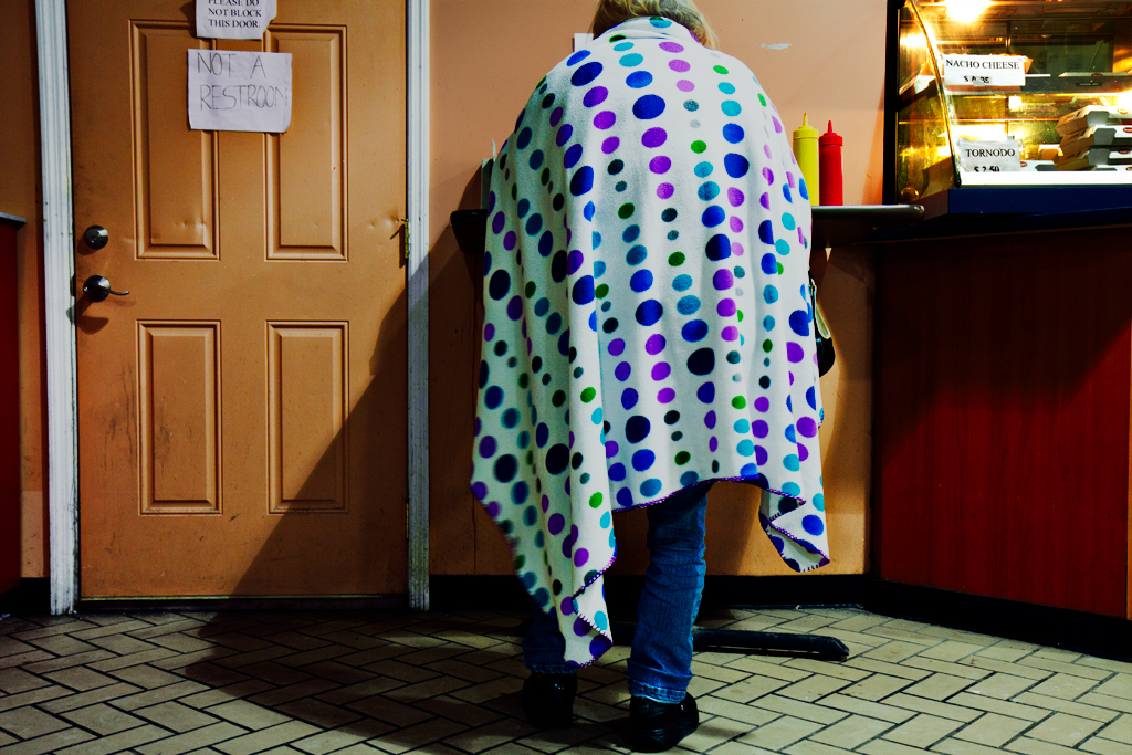 Woman-wrapped-in-dotted-blanket-at-bus-station--Indianapolis