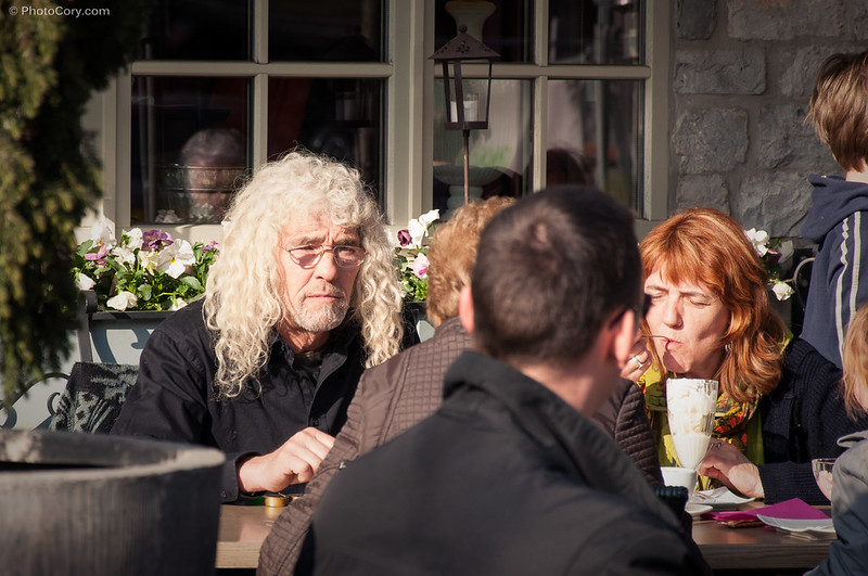 A man with long, white hair enjoying the sun