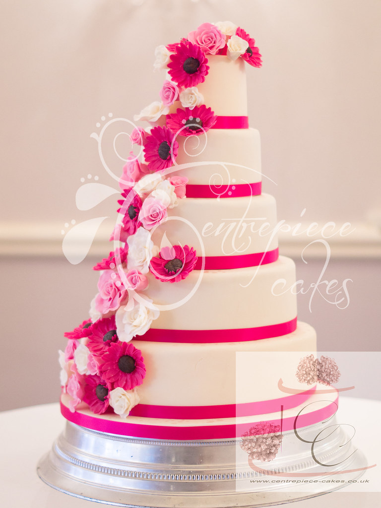 fuschia pink wedding cakes centrepiece cakes pink roses and gerbera cascade wed 14624
