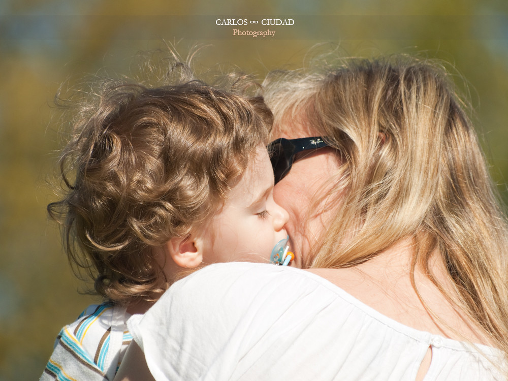 2 mature woman kissing