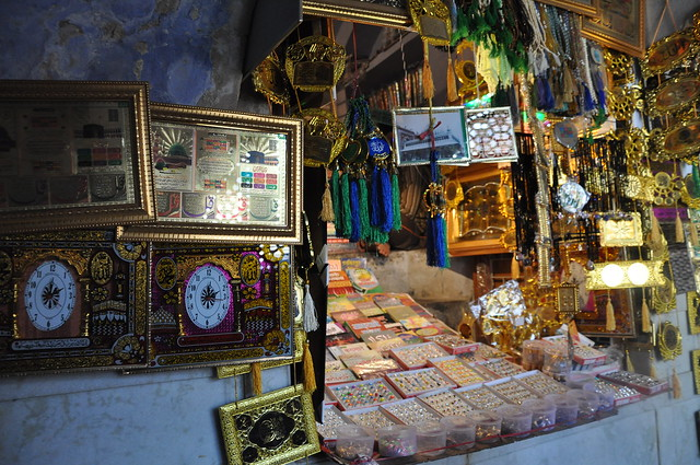 Amulets,charms,'chadars' and other artefacts adorn tiny shops along the passageway that leads to the 'baoli'.
