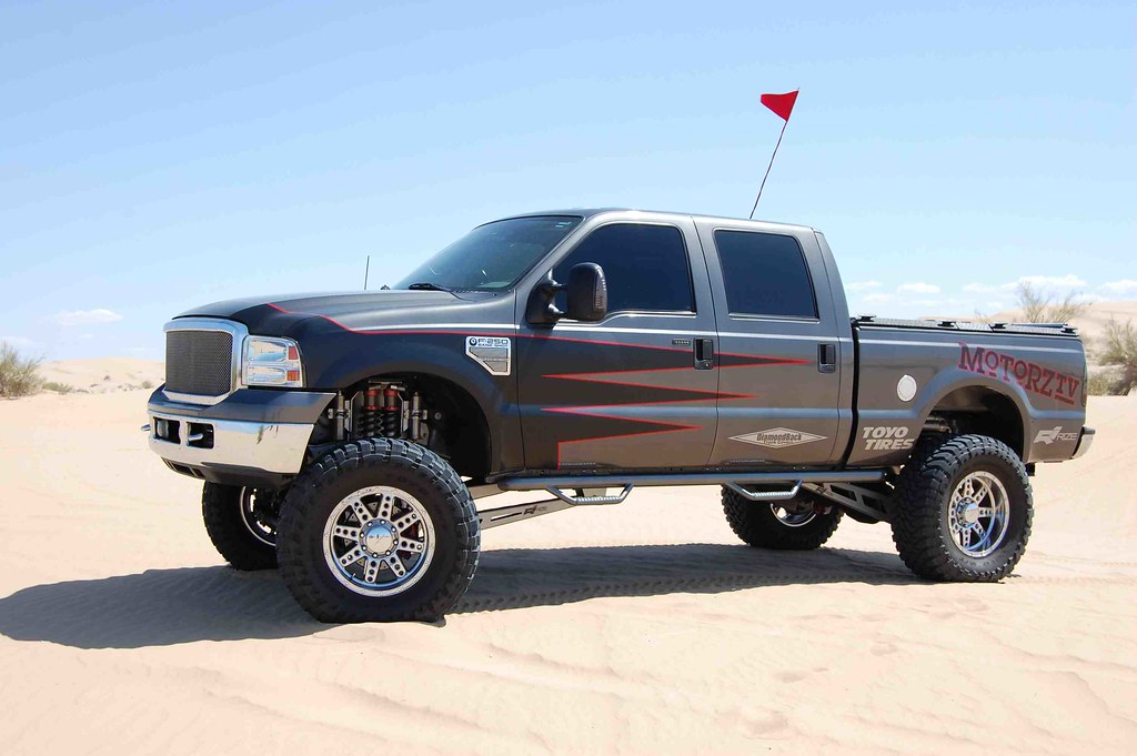 Lifted F 250 Sporting A Black Heavy Duty Truck Bed Cover