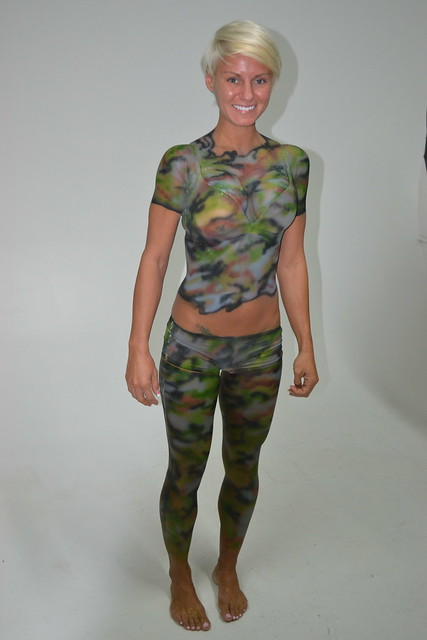Paintball girls in camo body paint thank for