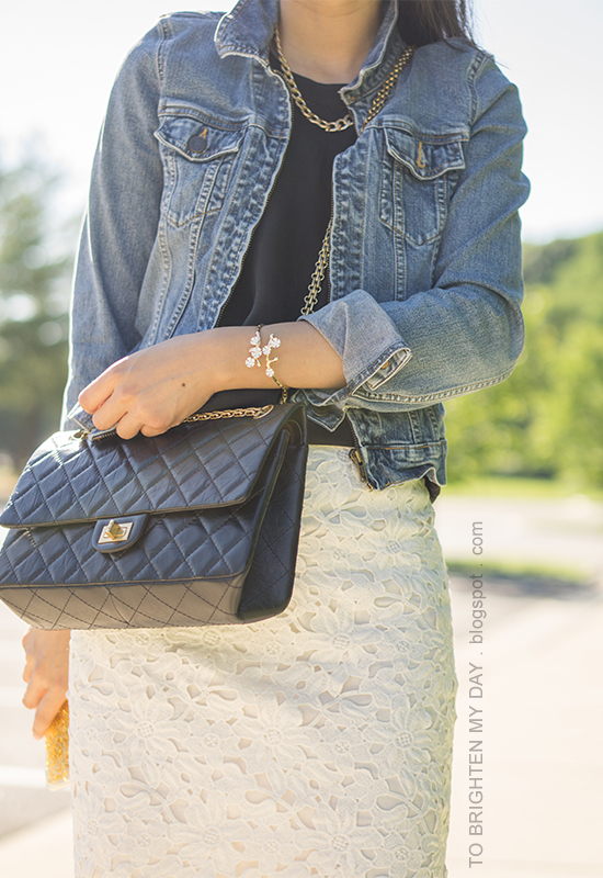 denim jacket, gold jewelry, black top, white lace pencil skirt