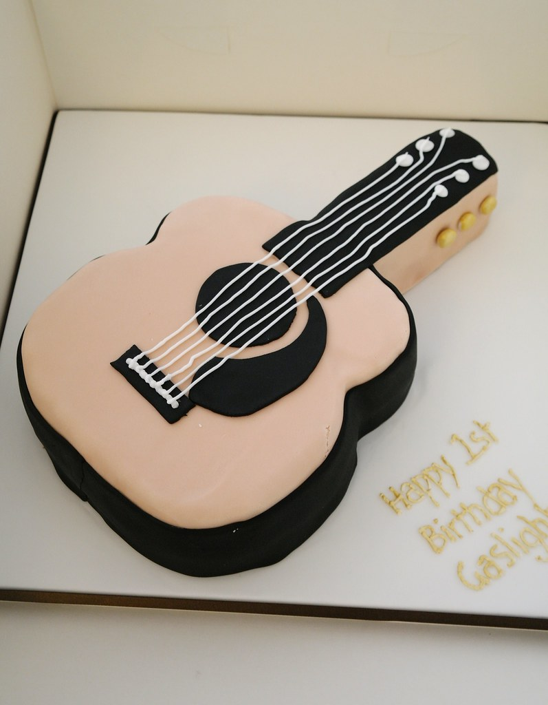 acoustic guitar cake acoustic guitar shaped cake for first flickr. Black Bedroom Furniture Sets. Home Design Ideas
