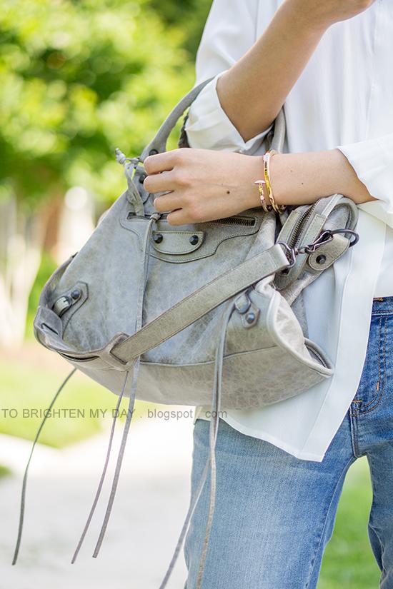 white boyfriend silk button up shirt, lightwash skinny jeans, gray bag, rose gold jewelry