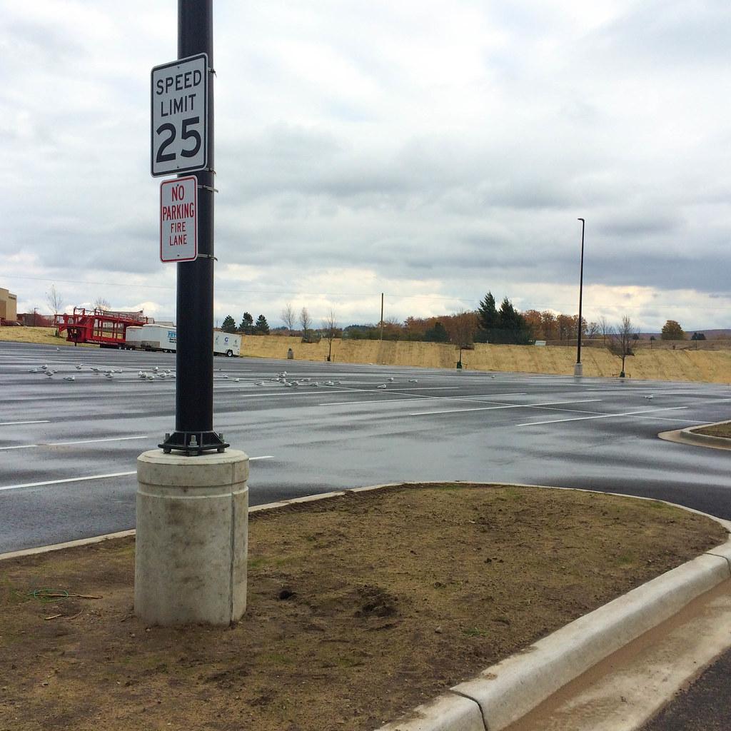 Smooth Round Pole Base for Petoskey Stadium Parking Lot2