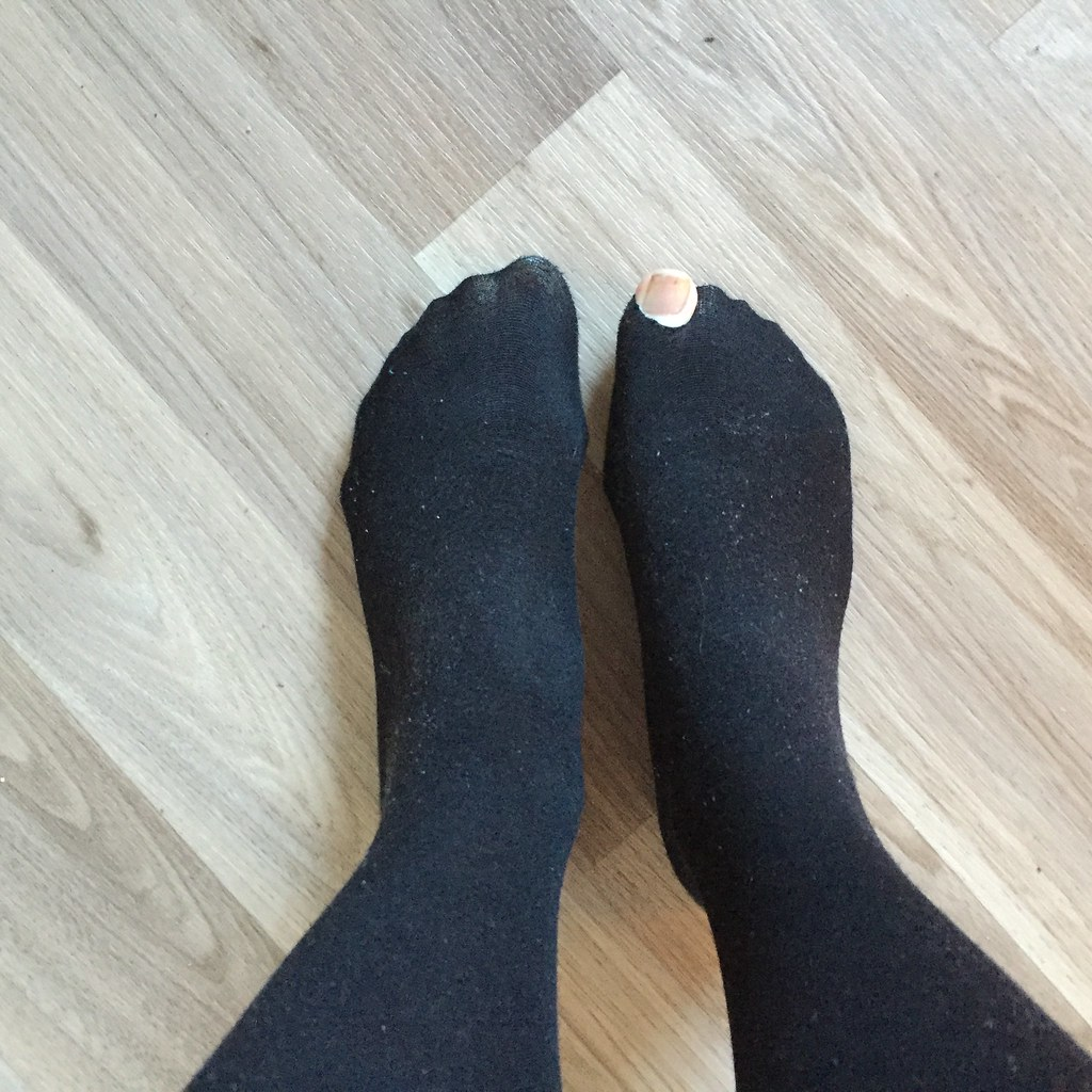 big toe poking through a hole in my tights