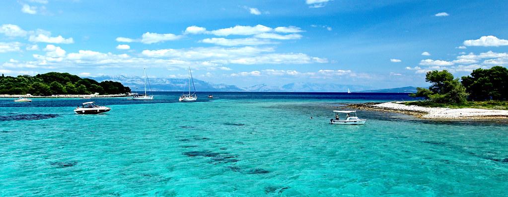 croatia near split the blue lagoon between the islands. Black Bedroom Furniture Sets. Home Design Ideas