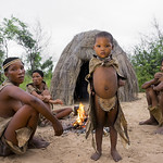 Bushman People Around A Fire In A Traditional Village, Tsumkwe, Namibia